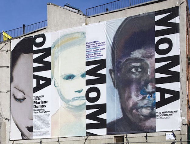 "graphic design for a billboard on a building showing three half-faces with bold text that says ""MoMA"""